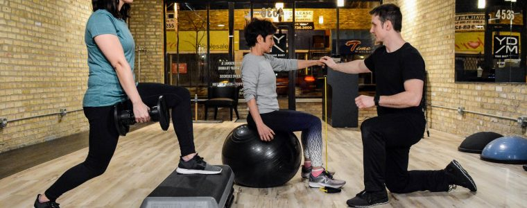 Two women training during a group exercise class at Your Daily Move