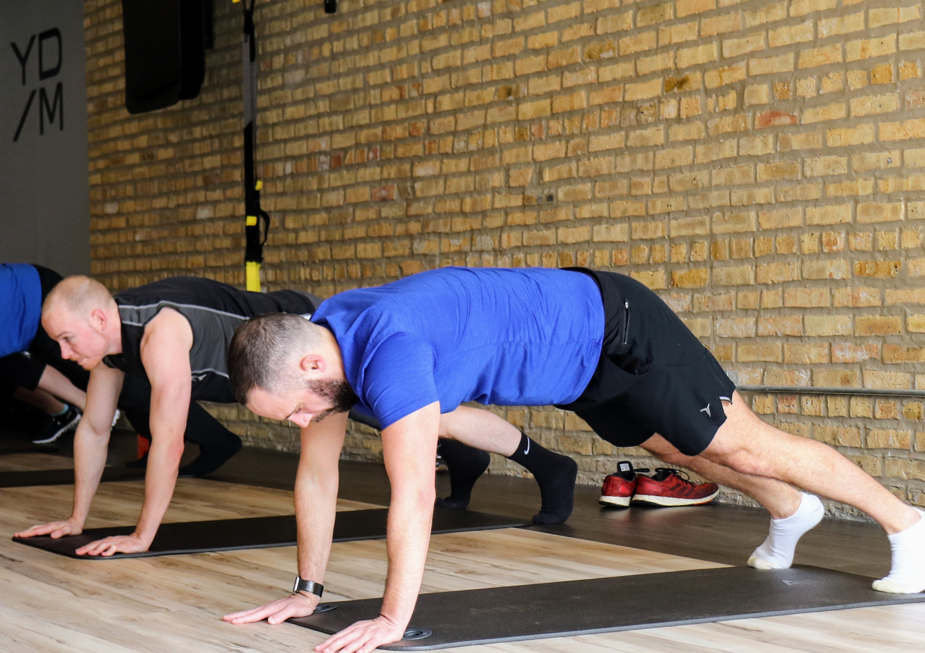 man performing plank exercise on mat